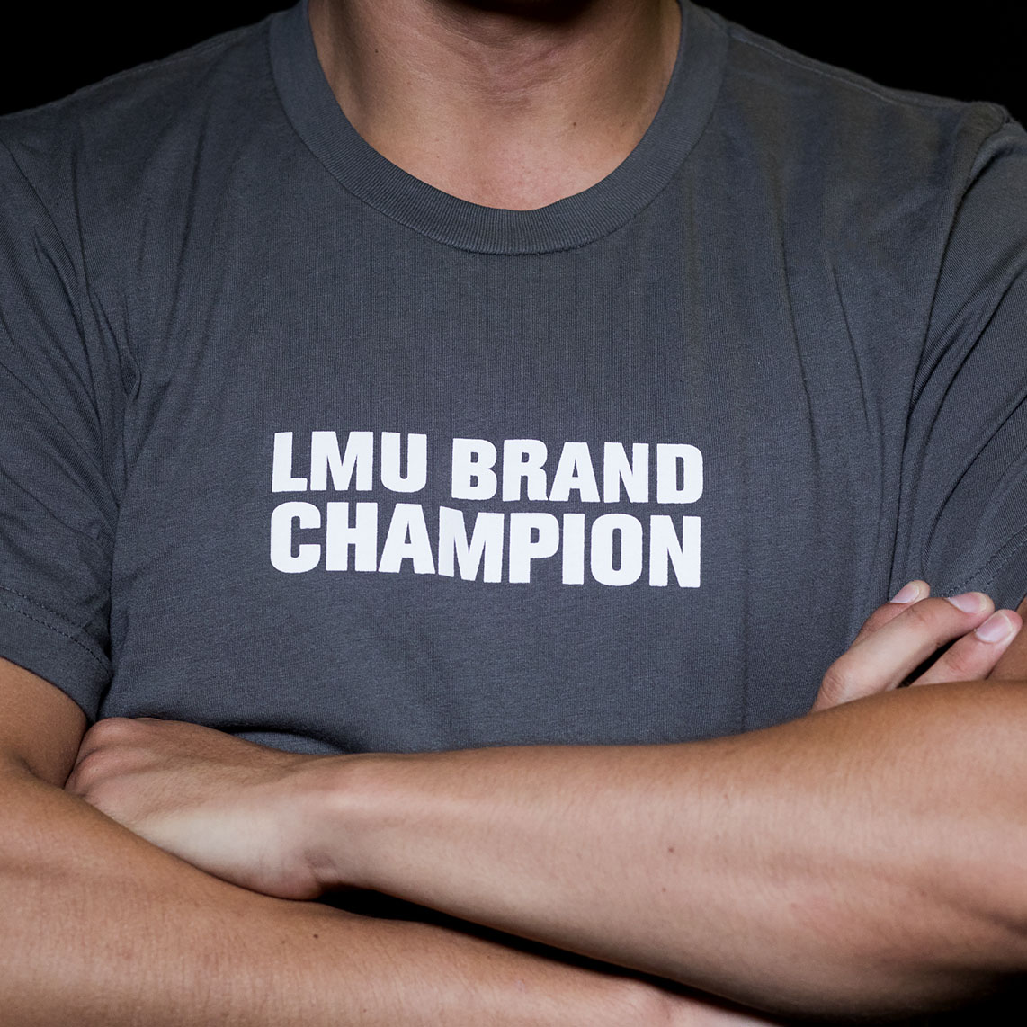 t-shirt that reads LMU BRAND CHAMPION